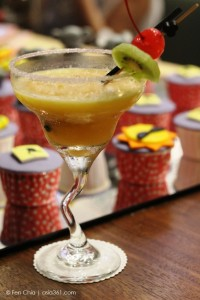 "Our ""sunset"" mocktail was made from kiwi, orange, a strawberry and lemon zest."