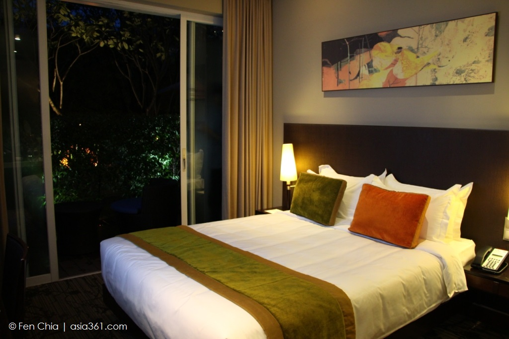 Every room, regardless of category, features the Park Regis' signature bed.  This room, a Quay room, has direct access to the pool.