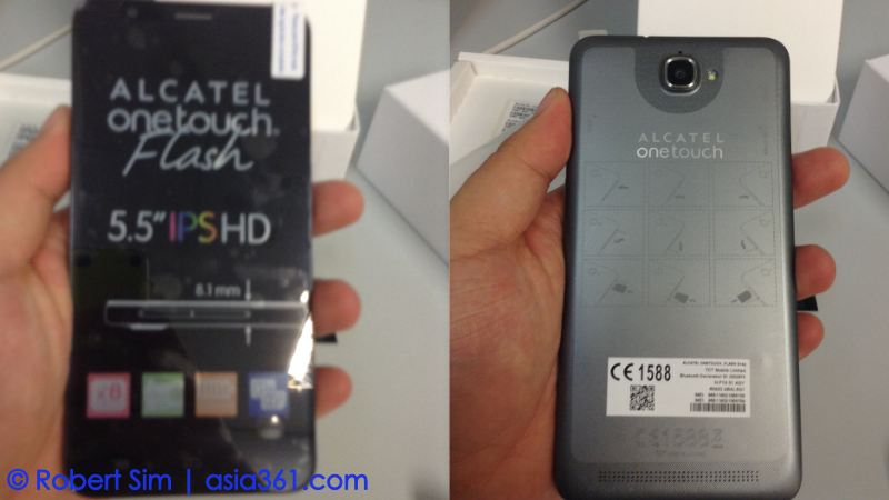 The front and back of the phone. The front has a protective film pre-applied and the back has instructions to insert the cards.