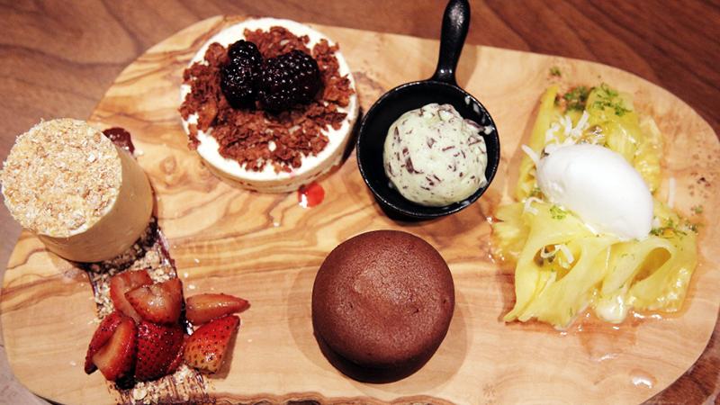 (Clockwise from top) Banana sticky toffee, Mint ice cream, Pineapple carpaccio, Chocolate fondant, strawberries, Cheesecake