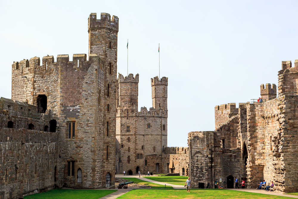 Caernarfon Castle in Wales. Photo © Gyvafoto | Shutterstock