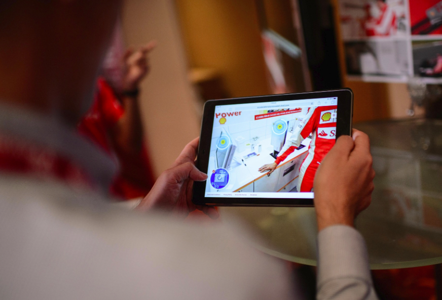 A guest at the launch event of Shell V-Power Nitro+ tries out the Scuderia Ferrari Uncovered web experience.