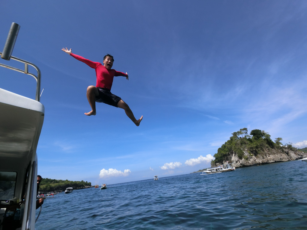 Leaping off the top of the boat in Bali. Photo courtesy of Jaclynn from theoccasionaltraveller.com