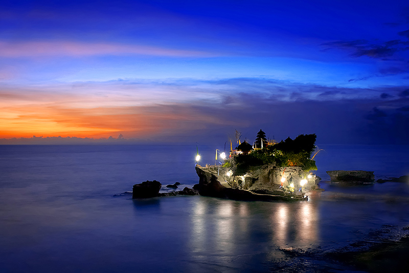 """Tanah Lot Temple. Photo © ,a href=""""http://www.shutterstock.com/pic-378716110/stock-photo-balinese-temple-in-the-sunset-tanah-lot-bali-a-beautiful-landscape-of-hinduism-temple-located-in.html?src=0nDZk6hNcXC8zU_bLsaT2g-1-25"""">ariefsetiawan"""