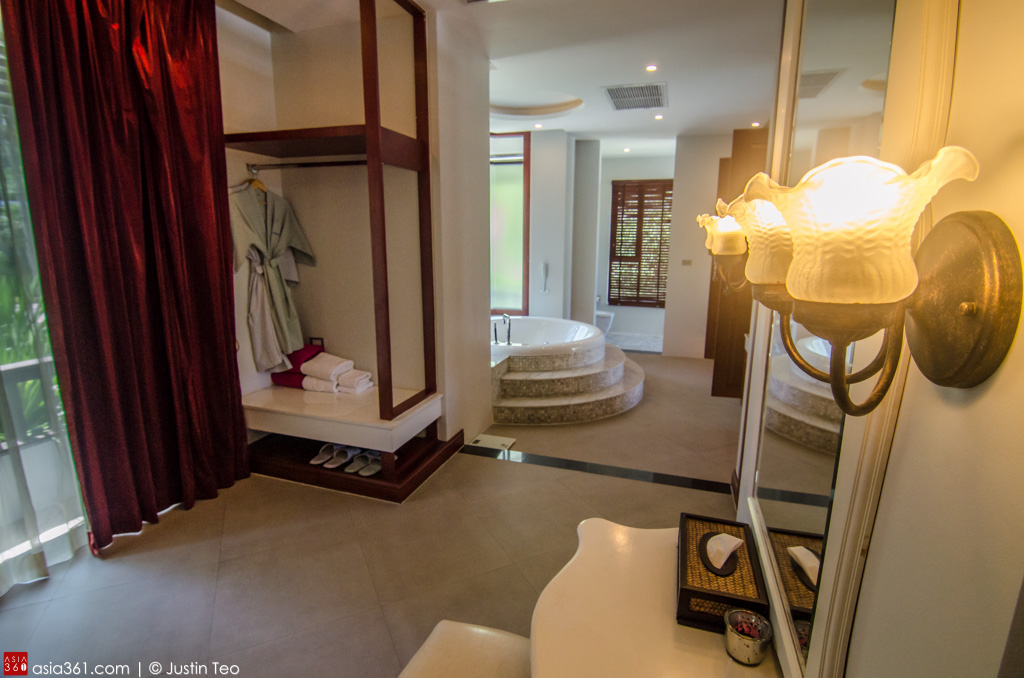 The walk-in wardrobe and bath area at the Deluxe Suite with Private Pool.