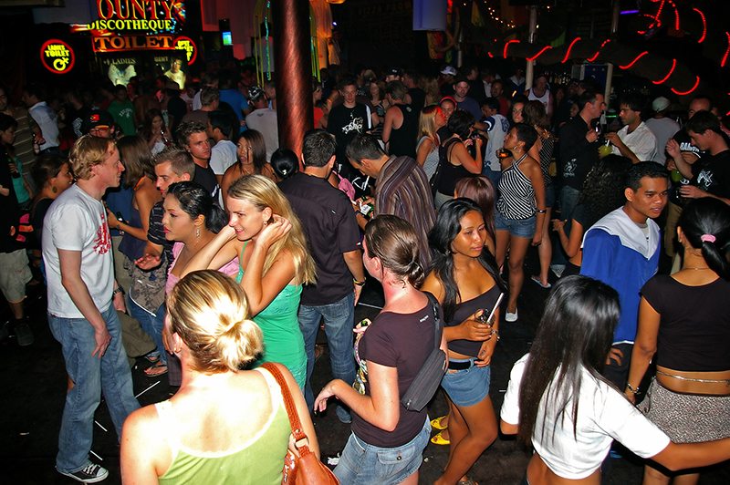 Tourists and locals at a night club in Kuta. Photo © Komar / Shutterstock