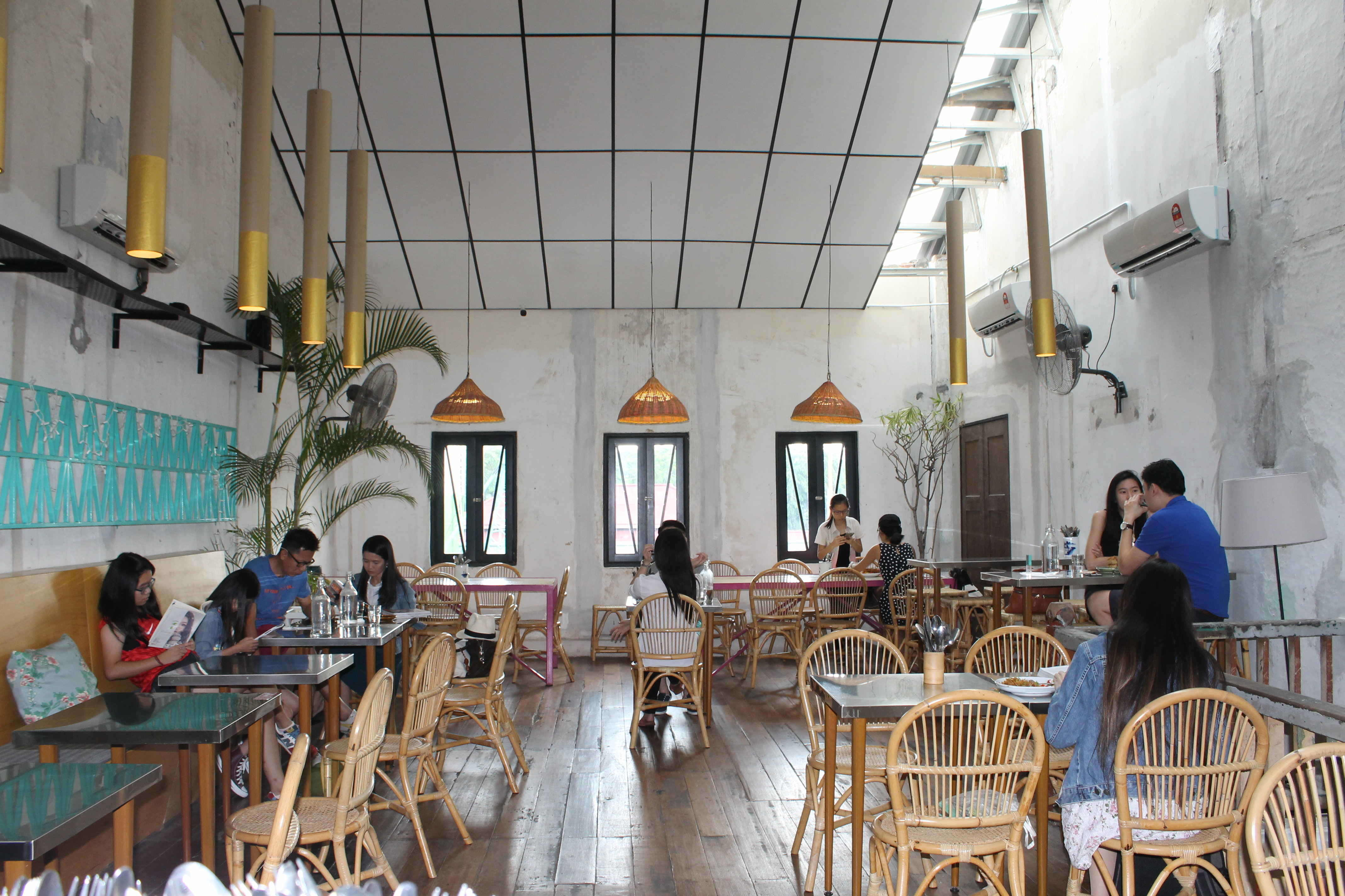 merchants lane may look old and a little worn out but the owners used this trait as the focal point of the whole cafe and created a rustic yet vibrant