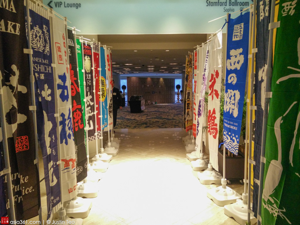 Flags of breweries flanking the walkway to the Sake Appreciation Singapore 2016.
